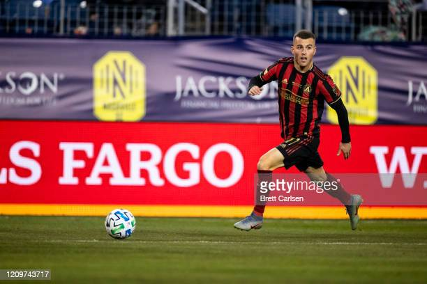 Brooks Lennon of the Atlanta United sets up a cross against the Nashville SC during the second half at Nissan Stadium on February 29 2020 in...
