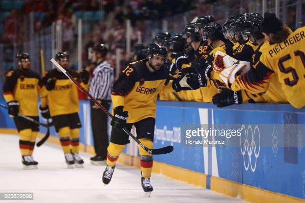 Brooks Macek of Germany celebrates after scoring a goal against Canada in the first period during the Men's Playoffs Semifinals on day fourteen of...