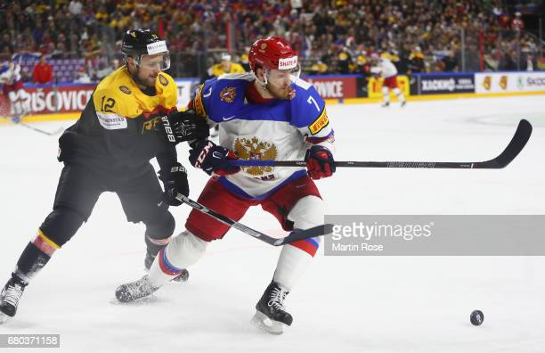 Brooks Macek of Germany challenges Ivan Telegin of Russia during the 2017 IIHF Ice Hockey World Championship game between Germany and Russia at...