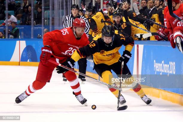 Brooks Macek of Germany competes for the puck against Ilya Kablukov of Olympic Athlete from Russia in overtime during the Men's Gold Medal Game on...