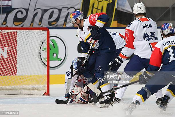 Brooks Macek of Munich and Victor Andren of Vaxjo during the Champions Hockey League Round of 32 match between Red Bull Munich and Vaxjo Lakers at...