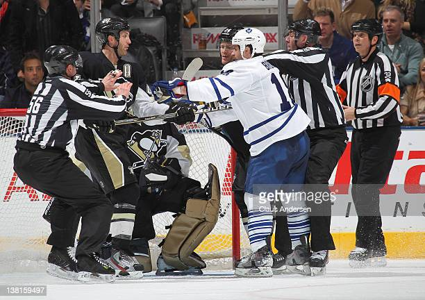 Brooks Orpik of the Pittsburgh Penguins and Mike Brown of the Toronto Maple Leafs are separated in a game on February 1 2012 at the Air Canada Centre...