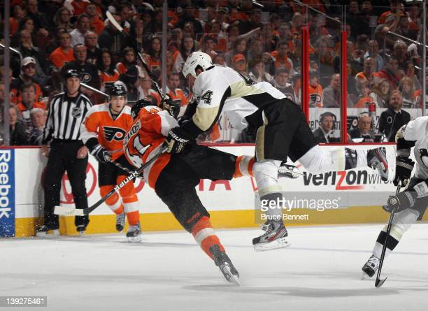 Brooks Orpik of the Pittsburgh Penguins hits Andrej Meszaros of the Philadelphia Flyers in a center ice check at the Wells Fargo Center on February...
