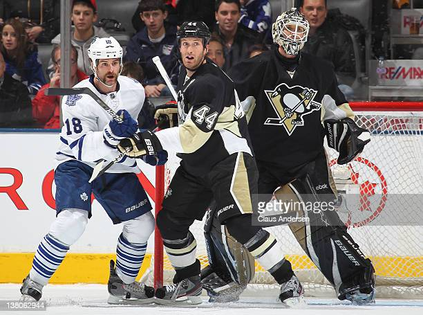 Brooks Orpik of the Pittsburgh Penguins holds Mike Brown of the Toronto Maple Leafs in check in a game on February 12012 at the Air Canada Centre in...