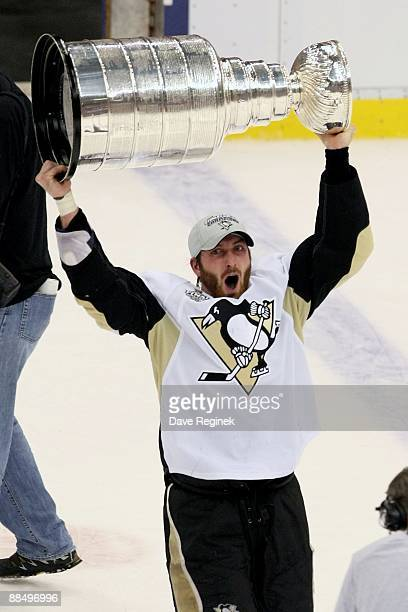 Brooks Orpik of the Pittsburgh Penguins skates around with the Stanley Cup after Game Seven of the 2009 NHL Stanley Cup Finals against the Detroit...