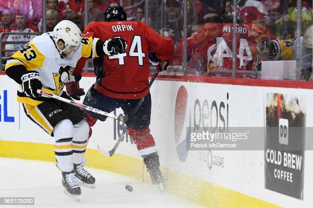 Brooks Orpik of the Washington Capitals and Conor Sheary of the Pittsburgh Penguins battle for the puck in the second period in Game Five of the...