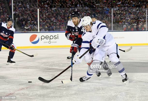Brooks Orpik of the Washington Capitals and Kasperi Kapanen of the Toronto Maple Leafs vie for the puck during the 2018 Coors Light NHL Stadium...