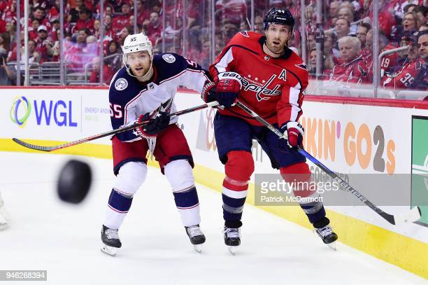 Brooks Orpik of the Washington Capitals and Mark Letestu of the Columbus Blue Jackets battle for the puck in the second period in Game One of the...