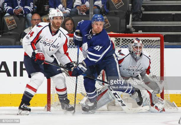 Brooks Orpik of the Washington Capitals battles against Leo Komarov of the Toronto Maple Leafs in Game Four of the Eastern Conference Quarterfinals...