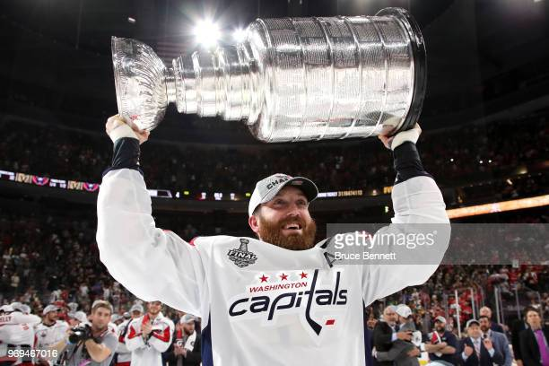 Brooks Orpik of the Washington Capitals hoists the Stanley Cup after his team defeated the Vegas Golden Knights 43 in Game Five of the 2018 NHL...