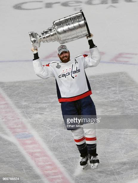 Brooks Orpik of the Washington Capitals hoists the Stanley Cup after the team's 43 win over the Vegas Golden Knights in Game Five of the 2018 NHL...