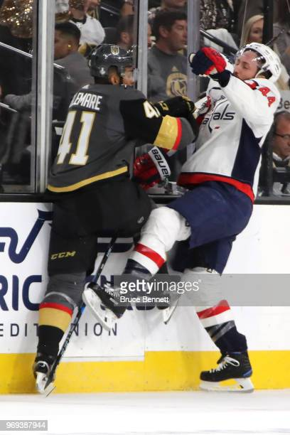 Brooks Orpik of the Washington Capitals is checked by PierreEdouard Bellemare of the Vegas Golden Knights during the first period in Game Five of the...