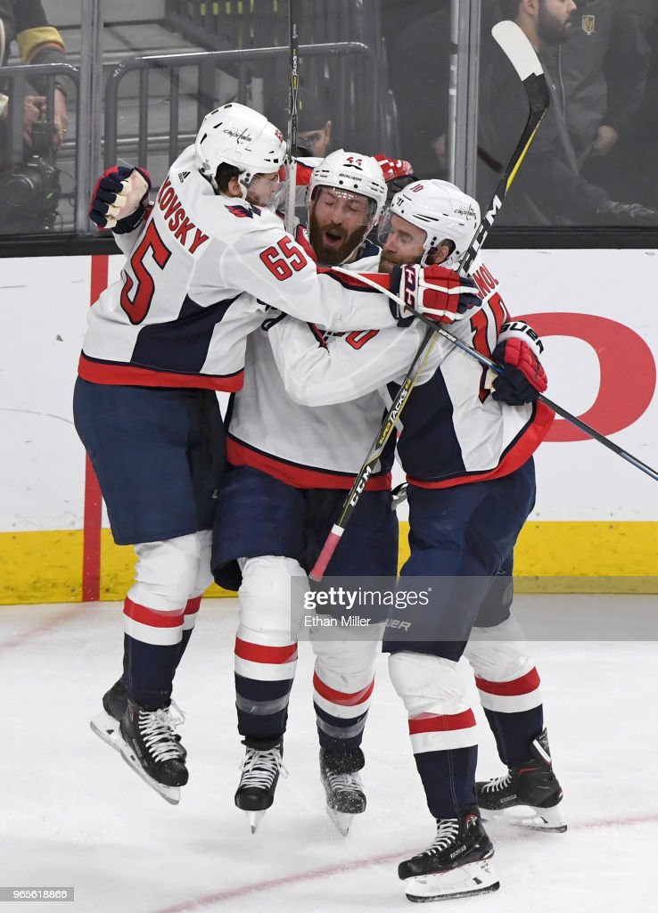 Brooks Orpik #44 of the Washington Capitals is congratulated by teammates Andre Burakovsky #65 and Brett Connolly #10 after scoring a second-period goal against the Vegas Golden Knights in Game Two of the 2018 NHL Stanley Cup Final at T-Mobile Arena on May 30, 2018 in Las Vegas, Nevada. The Capitals defeated the Golden Knights 3-2.