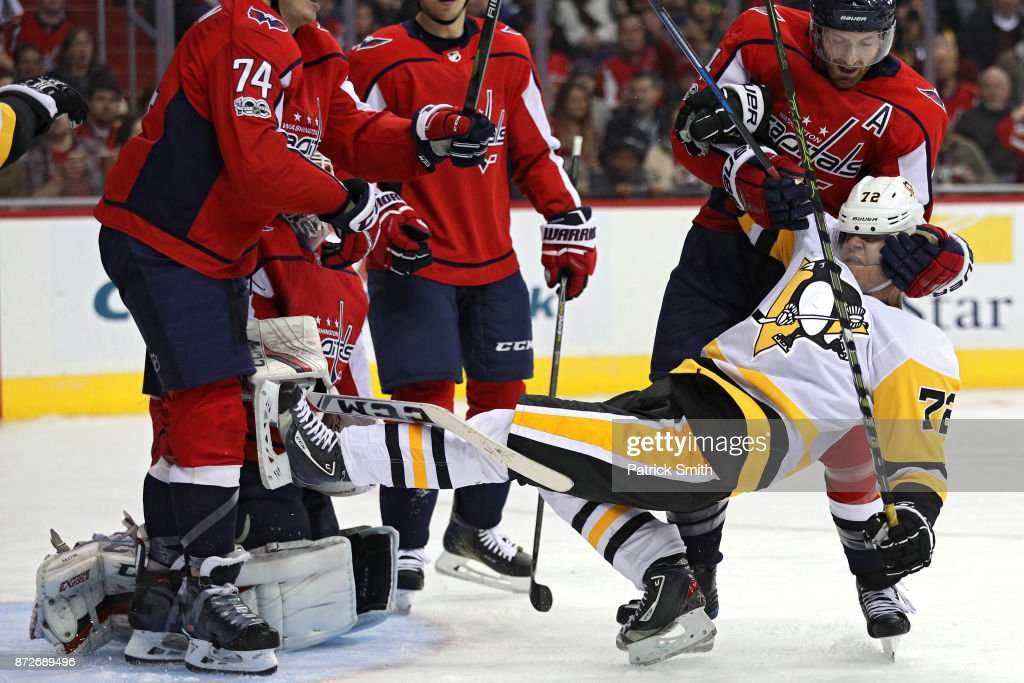 Brooks Orpik #44 of the Washington Capitals pulls down Patric Hornqvist #72 of the Pittsburgh Penguins during the third period at Capital One Arena on November 10, 2017 in Washington, DC.