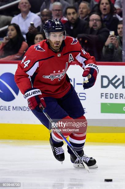 Brooks Orpik of the Washington Capitals skates with the puck in the third period against the Vancouver Canucks at Capital One Arena on January 9 2018...