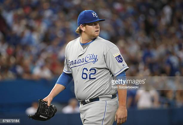 Brooks Pounders of the Kansas City Royals walks off the mound at the end of the sixth inning during MLB game action against the Toronto Blue Jays on...