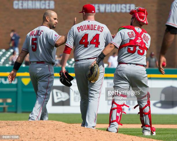 Brooks Pounders of the Los Angeles Angels of Anaheim celebrates with Albert Pujols and Juan Graterol after a MLB game against the Detroit Tigers at...