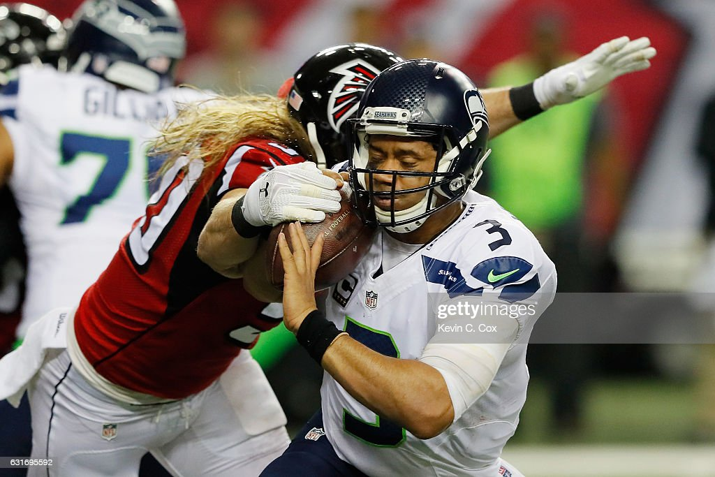 Brooks Reed #50 of the Atlanta Falcons tackles Russell Wilson #3 of the Seattle Seahawks at the Georgia Dome on January 14, 2017 in Atlanta, Georgia.