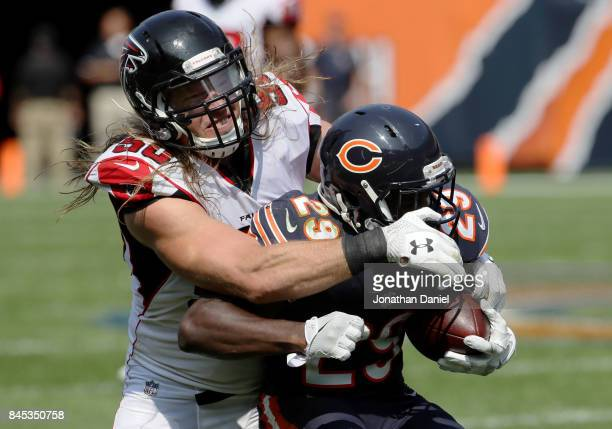 Brooks Reed of the Atlanta Falcons tackles Tarik Cohen of the Chicago Bears in the third quarter at Soldier Field on September 10 2017 in Chicago...
