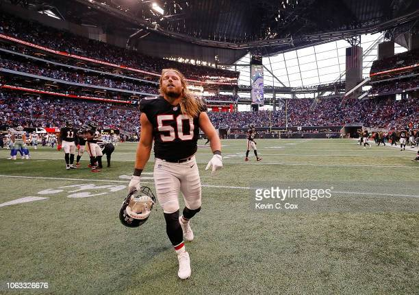 Brooks Reed of the Atlanta Falcons walks off the field after their 2219 loss to the Dallas Cowboys at MercedesBenz Stadium on November 18 2018 in...