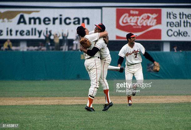 Brooks Robinson and Mike Cuellar of the Baltimore Orioles celebrate after winning Game Five the World Series against the Cincinnati Reds at Memorial...