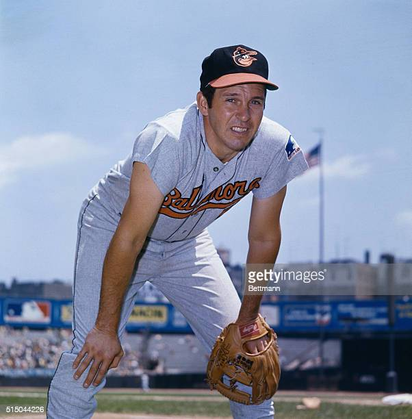 Brooks Robinson infielder for the Baltimore Orioles is shown crouching down with his hands on his knees in a playing position