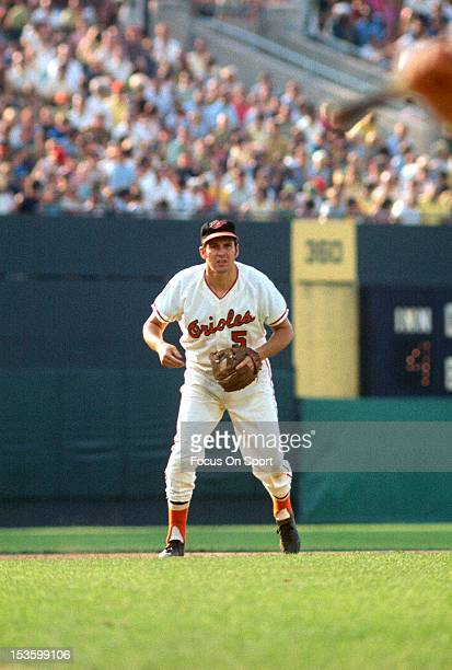 Brooks Robinson of the Baltimore Orioles is down and ready to make a play on the ball during an Major League Baseball game circa 1966 at Memorial...