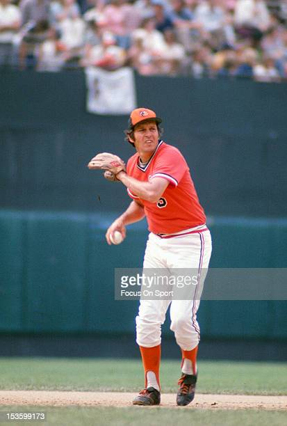 Brooks Robinson of the Baltimore Orioles looks to throw the ball to first base during an Major League Baseball game circa 1975 at Memorial Stadium in...