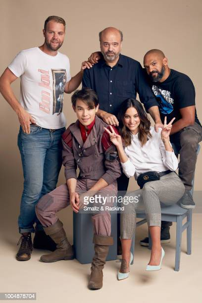 Brooks Wheelan Ryan Potter Scott Adsit Genesis Rodriguez and Khary Payton from Disney's 'Big Hero 6' pose for a portrait at the Getty Images Portrait...