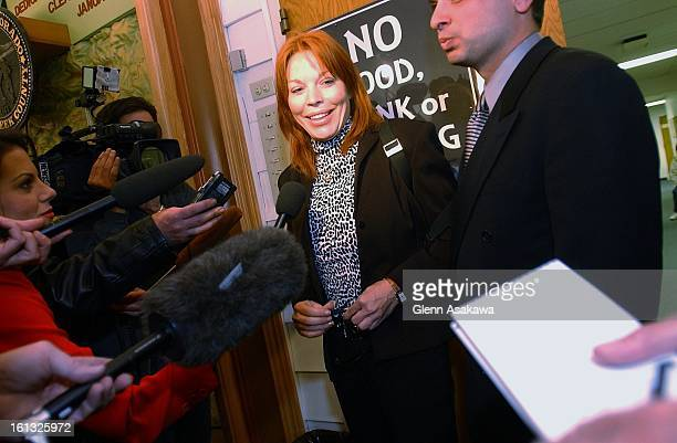 BROOKS41102Former Georgetown Mayor Koleen Brooks talks to reporters after her first court appearance on charges she facked the attack against her...