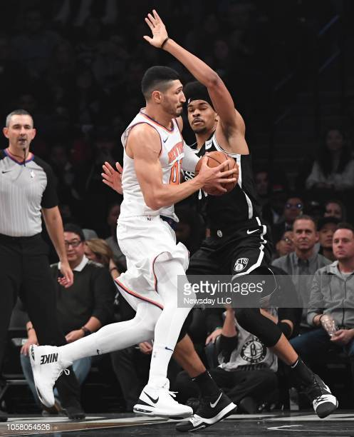 New York Knicks center Enes Kanter drives to the basket defended by Brooklyn Nets center Jarrett Allen in the first half of an NBA basketball game at...