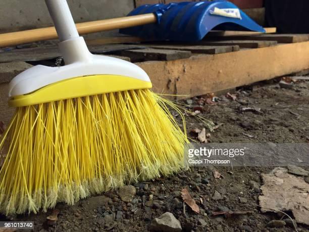 broom and shovel resting on ground - 箒 ストックフォトと画像