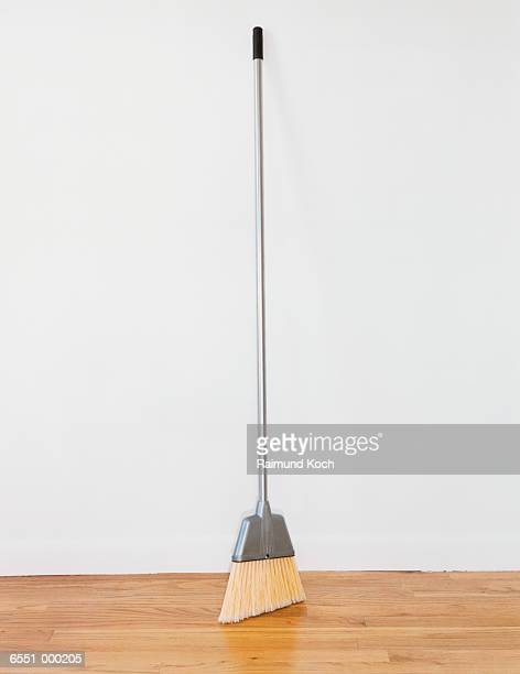 broom in empty room - broom stock pictures, royalty-free photos & images