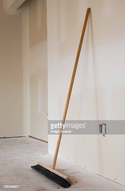 broom leaning against a wall - broom stock pictures, royalty-free photos & images