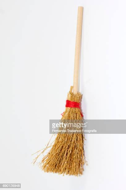 broom leaning against wall - broom stock pictures, royalty-free photos & images