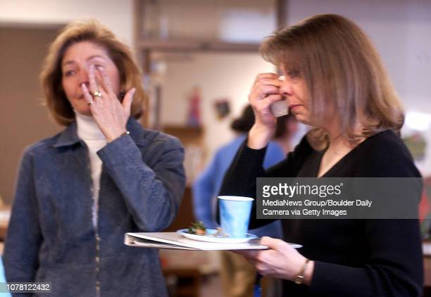 Broomfield Heights Middle School teachers Patti Wagner left and Annette Roden cry after the dedicaton of the school's library to librarian Mary...
