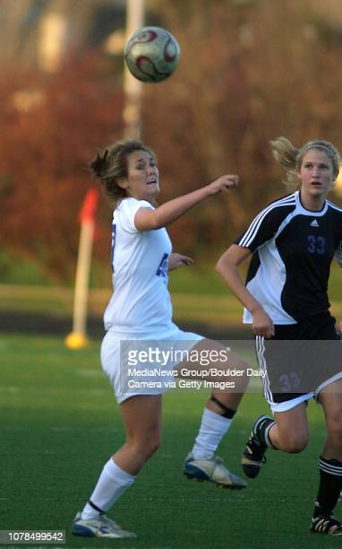 Broomfield High School left moves the ball away from Mountain View High School with her head during play at Elizabeth Kennedy Stadium on Tuesday