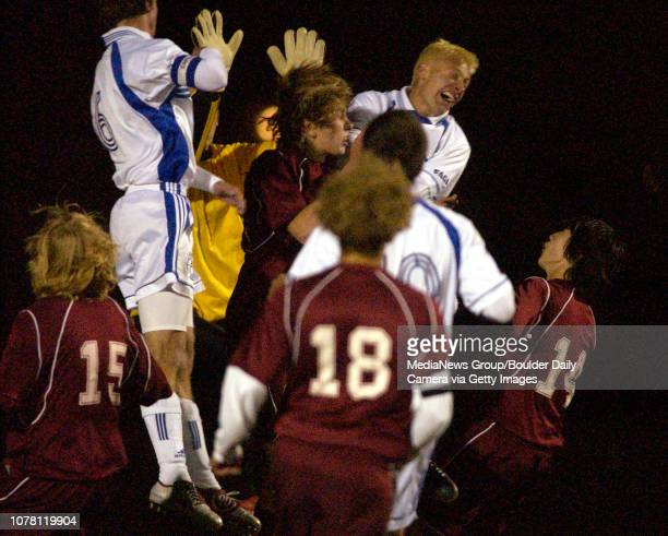 Broomfield High School players and Windsor High School players alike go for the ball during a corner kick on Friday at Elizabeth Kennedy Stadium