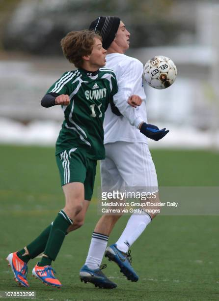 Broomfield's Connor Mtezger fights for control of the ball against Summit's Daniel McFadden during Thursday's game at Elizabeth Kennedy Stadium...