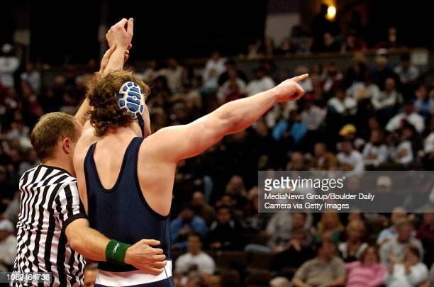 Broomfield's David Marrone's arm is raised in victory after pinning Greeley West's Justin Waterman during their match in the 215pound division of the...