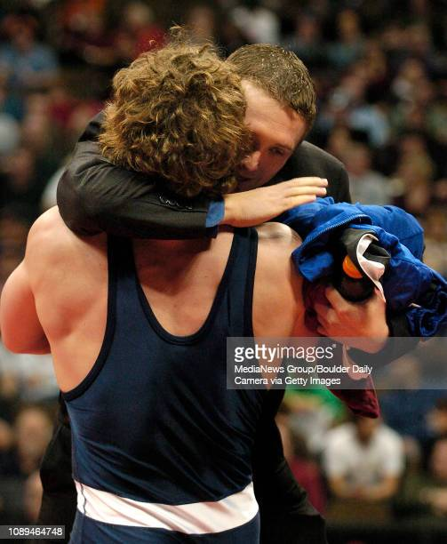 Broomfield's David Marrone's hugs his coach Travis Masse in victory after pinning Greeley West's Justin Waterman during their match in the 215pound...