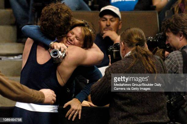 Broomfield's David Marrone's hugs his mother Terri Morrone in victory after pinning Greeley West's Justin Waterman during their match in the 215pound...