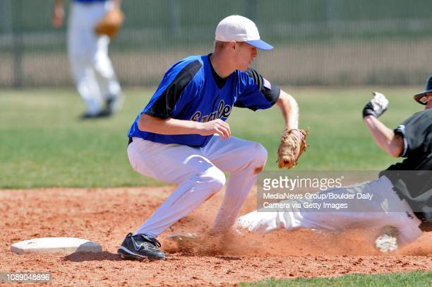 Broomfield's Mick Ramsey receives the throw from the catcher to tag Canyon City's Brandon McCain out at second base during their district baseball...