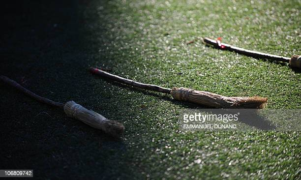 Brooms lie ready to be ridden prior to the start of a Quidditch match Harry Potter's magical and fictional game during the 4th Quidditch World Cup in...