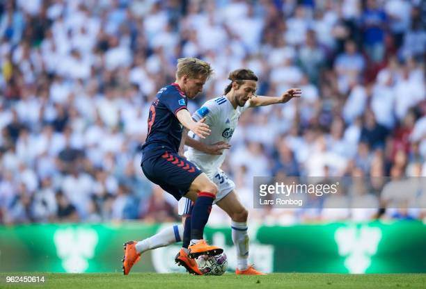Bror Blume of AGF Aarhus and Rasmus Falk of FC Copenhagen compete for the ball during the Danish Alka Superliga Europa League Playoff match between...