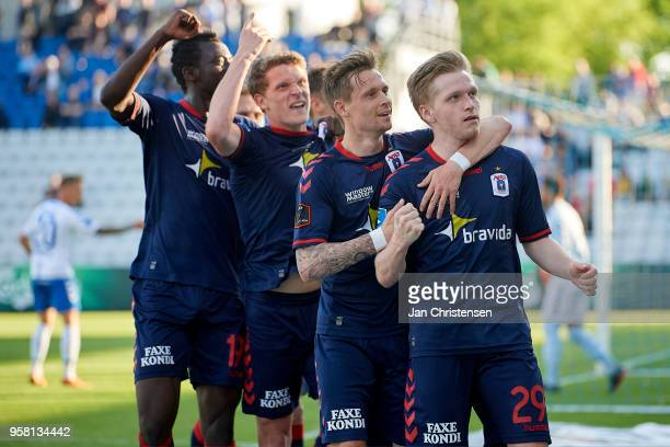 Bror Blume of AGF Arhus and teammates celebrate his 02 goal during the Danish Alka Superliga match between OB Odense and AGF Arhus at EWII Park on...