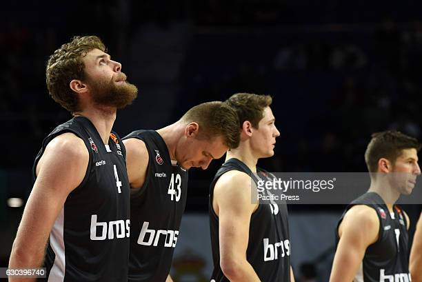 Brose Bamberg players keep a minute of silence for the victims of the Berlin Christmas market terror attack