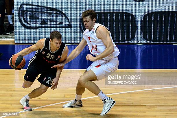 Brose Bamberg's guard Anton Gavel fights for the ball with Olimpia Milano's forward Alessandro Gentile during the Euroleague basketball match Olimpia...