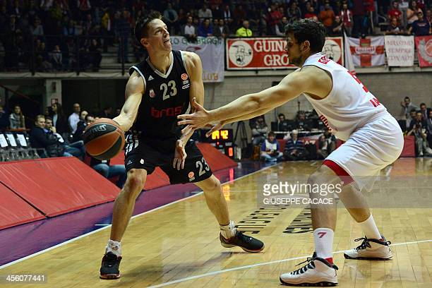 Brose Bamberg's guard Casey Jacobsen vies with Olimpia Milano's forward Alessandro Gentile during the Euroleague basketball match Olimpia Milano vs...