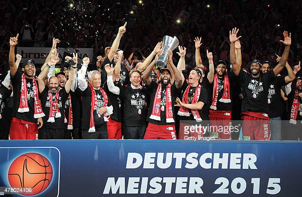Brose Baskets Bamberg celebrate winning the German basketball championship 2015 after Game Five of the 2015 BBL Finals at Brose Arena on June 21 2015...